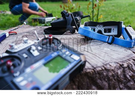 Video monitors-glasses and special devices for the control of the radio controlled sports drones, the model of the car. Entertainment for adults outdoors. Park and summer vacation.