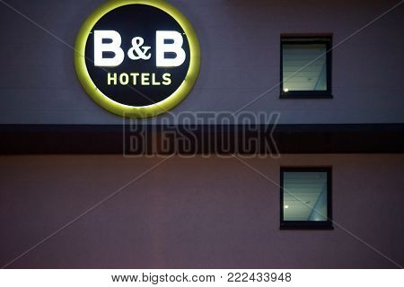DARMSTADT, GERMANY - OCTOBER 31: The facade of a neon-lit B and B hotel with neon lights and logo in the evening on October 31, 2017 in Darmstadt.