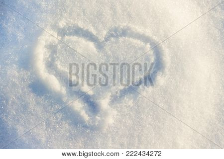 on the sun-lit snow painted a heart, a symbol of love in difficult circumstances