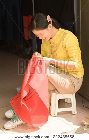 Young Woman - Dressmaker Embroider At The Entrance To His Atelier