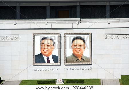 NORTH KOREA, PYONGYANG - SEPTEMBER 20, 2017: portraits of two presidents DPRK Kim Il Sung and Kim Jong Il on Great People's Study House, Kim Il Sung Square, capital of North Korea