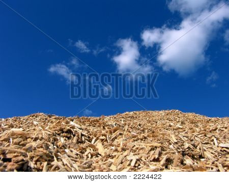 Mulch Wood Pieces And Blue Sky Background