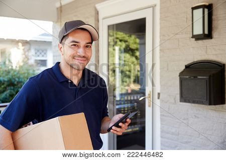 Portrait Of Courier With Digital Tablet Delivering Package poster