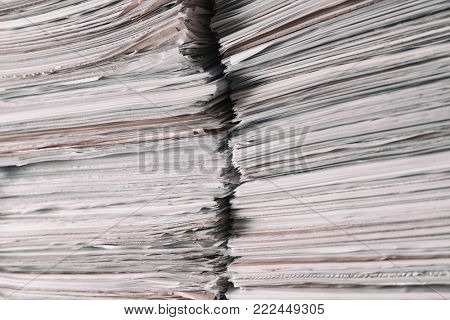 Stacks of old paper documents in archive, closeup