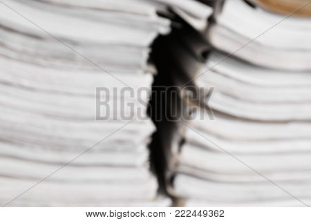 Blurred view of paper documents in archive