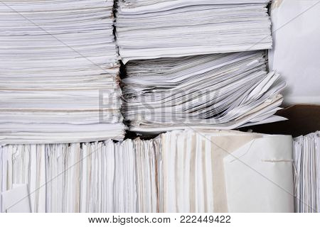 Stacks of old paper documents in archive
