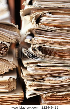 Stack of old documents in archive, closeup