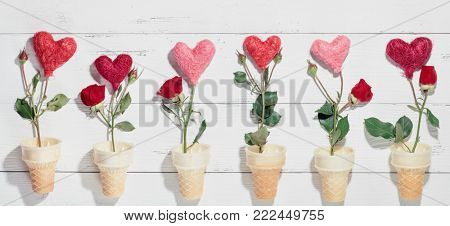 Ice cream cone and rose flower on wood