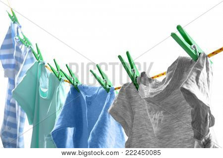 Clothes on laundry line against white background, closeup