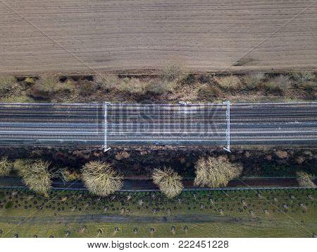 Electrified train train in countryside no train aerial photo