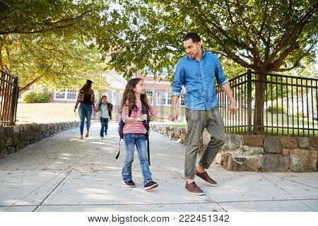 Father In Collecting Daughter At The End Of School