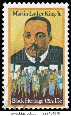 UNITED STATES OF AMERICA - CIRCA 1979: A stamp printed in USA shows Martin Luther King Jr. (1929 - 1968) and Civil Rights Marchers, Black Heritage series, circa 1979