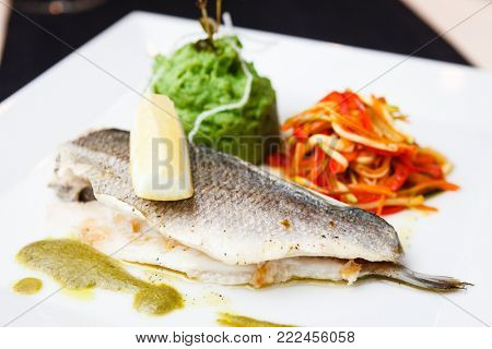 Dorada in herbs sauce with tender potato-spinach mousse