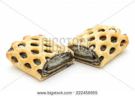 Sliced lattice bread two halves with coconut and chocolate mousse inside isolated on white background fresh baked