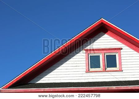 Detail of a red rooftop against a blue sky in Iles de la Madeleine in Canada