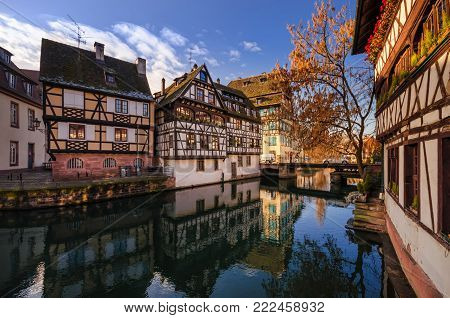 Beautiful views of historic city of Strasbourg and river Ill. Traditional half-timbered houses in Alsace. France.