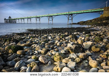 Clevedon pier and beach in sunlight on Somerset coast