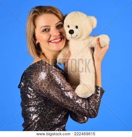 Tasty Toy Concept. Lady With Blond Hair Poses With Caramel