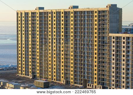 Building under construction. Construction site. Urban. Multistory High-rise building