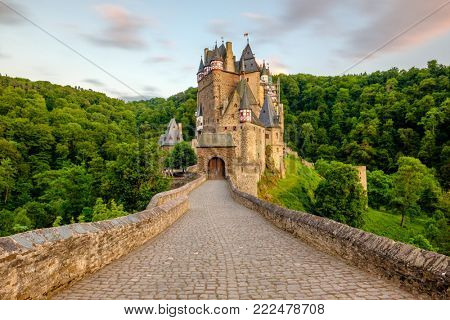 Burg Eltz castle in Rhineland-Palatinate state at sunset, Germany. Construction started prior to 1157.