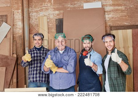 Craftsman team with thumbs up as motivation and consent