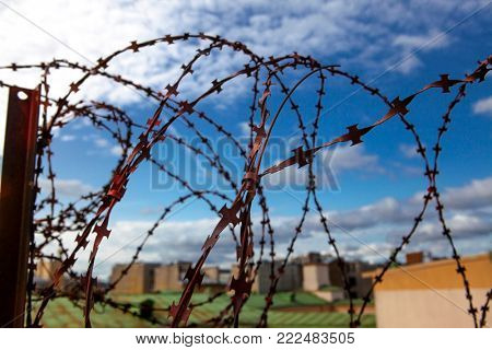 Barbed wire. Barbed wire on blue sky background with white clouds. Wire boom. Military conflict . Syria