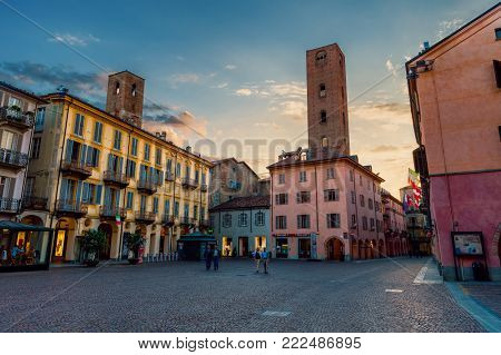 ALBA, ITALY - MAY 25, 2015: View of cobblestone central square of town among old houses and ancient towers in Alba - famous for white truffle festivals and wine production.