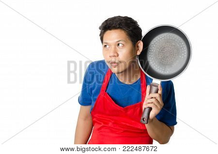 Asian man wear red apron holding a pan for cooking isolated on white background