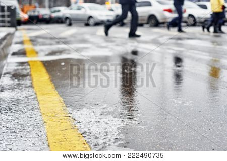 Closeup photo of winter snowy sleet road in the city