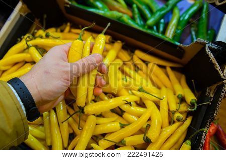 first person view man buy hot peppers in the store