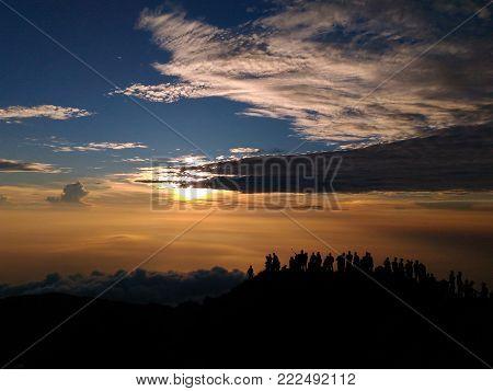 Fantastic dreamy sunrise on top of mountain. Mountain view. Dreamy forrest. Sunrise clouds. Forest hill.