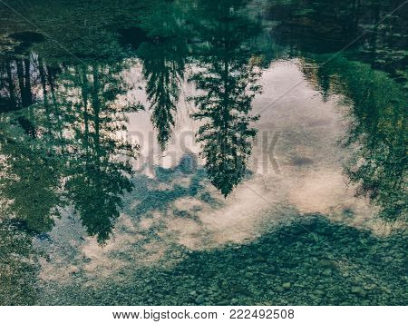 Reflection on water surface. Beautiful nature. Scenery reflection on water.