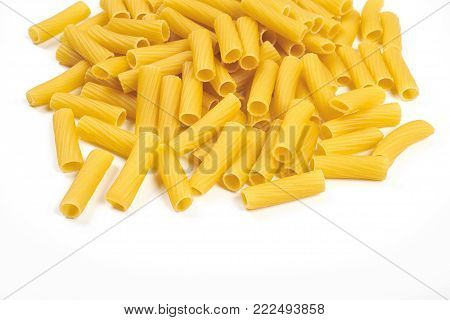 Rigatoni italian pasta isolated on white background.