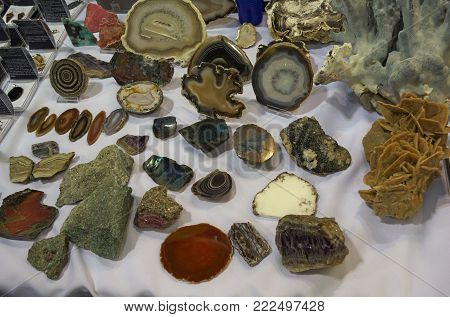 Lot of various different crystals displayed on table