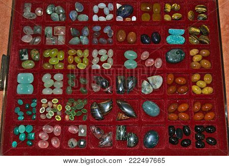 Lot of various different crystals displayed in showcase