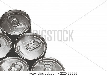 Top view of beverage cans with water droplets on white background; B&W color; right copy-space for add contents, or image montage. Concept of freshness, cold drinks, hygiene in food and drink, etc.