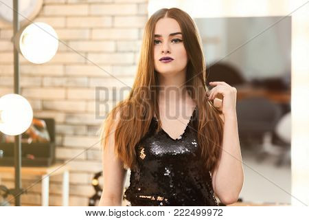 Beautiful young woman in makeup room