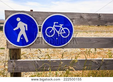 Prohibitory traffic sign. No car entry sign. No motor vehicle. Allow only bicycle and pedestrian on the wooden fence.