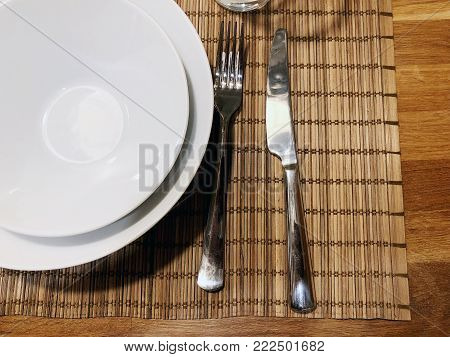 Cutlery set:spoon and knife on wooden table.Cutlery on wooden background.Can be used as background menu for restaurant.Top view.Copy space.Table setting