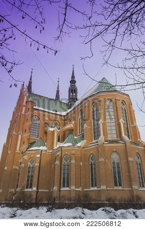 Poland, Radom, snow covered Cathedral, sunlit, Winter