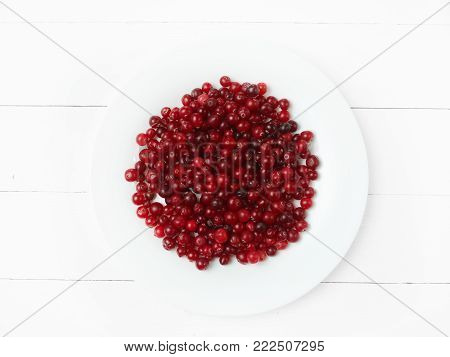 The fresh cowberries on old wooden table