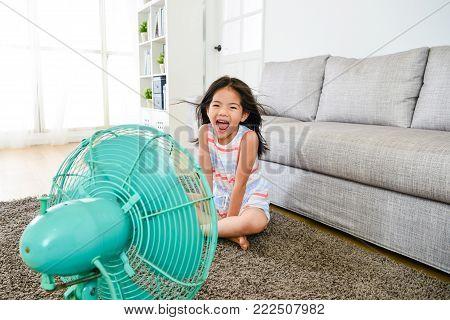 Beautiful Little Kid Girl Lying Down On Floor