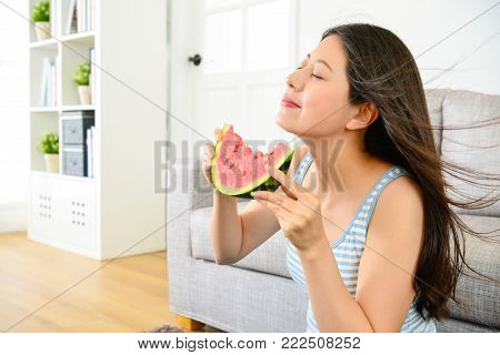 Elegant Young Woman Enjoying Sweet Watermelon