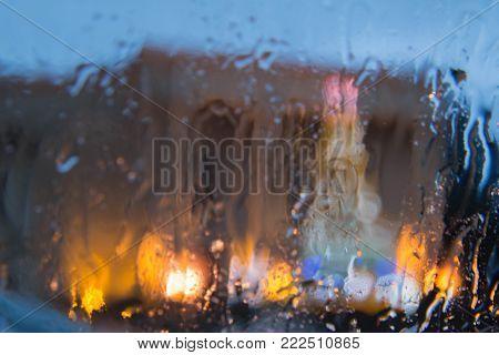 Rain drops on car glass. Rainy days, Night. Rain drops on window, rainy weather, rain background. Drops Of Rain On Glass Background