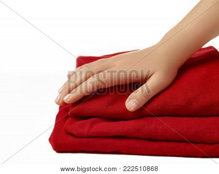 The red abstract cloth, fabric background and texture, curtain theater and female hand