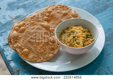 Indian food for breakfast. Papadum bread and vegetarian dal made from lentils or beans. Also popular in Nepalese, Pakistani, Sri Lankan and Bangladeshi cuisines.