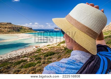 Woman with sunhat watching on beach at Balos in Crete, Greece