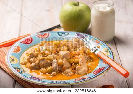 chicken breast with apple paprika and yogurt sauce, selective focus
