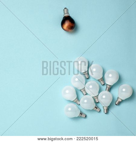 One light bulb outstanding, glowing different. Business creativity idea concepts. Flat lay design