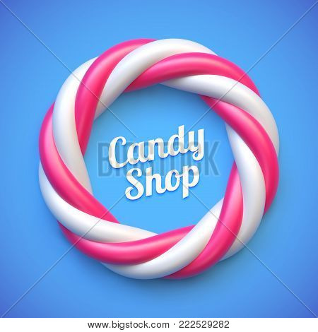 Candy cane circle frame on blue background. Swirl hard candy round border with copy space